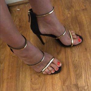 Bebe sexy black gold strappy heels 9